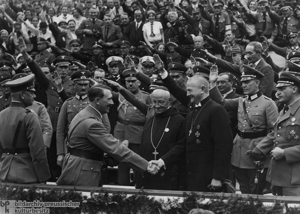 Adolf Hitler greeting Catholic leaders during a Nazi rally.