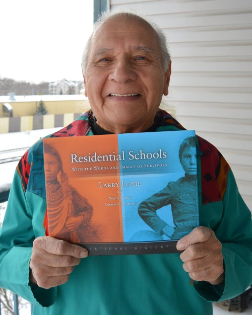 RS Larry with book on porch