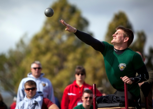 British Royal Marine Joe Townsend, a Wounded Warrior with the Allies Team, shot puts during the 2012 Marine Corps Trials, hosted by the Wounded Warrior Regiment, at Marine Corps Base Camp Pendleton, Calif., Feb. 19, 2012. Townsend, from Eastbourne, England, placed first in the 10-kilometer hand cycling competition and 200-meter wheelchair race. Wounded Warrior Marines, veterans and allies are competing in the second annual trials, which include swimming, wheelchair basketball, sitting volleyball, track and field, archery and shooting. The top 50 performing Marines will earn the opportunity to compete in the Warrior Games in Colorado Springs, Colo., in May.